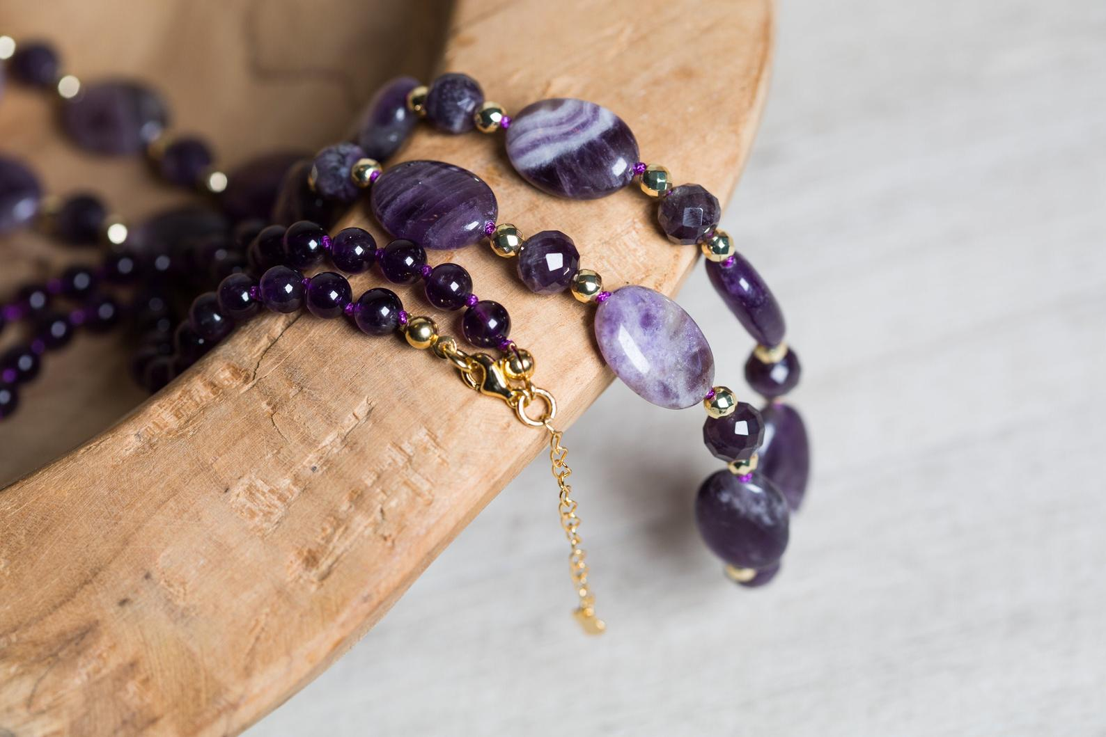 This beautiful necklace is flawlessly made with natural Amethyst oval, round and faceted beads. Among them, there are golden Hematite beads that highlight the deep shine of Amethyst. It's fully hand-knotted with a purple cord, assigning strength and durability while the design completes with a lobster claw clasp. It's worth mentioning that the clasp and the rest findings are made of 18ct gold plated, 925 sterling silver, adding luxury and elegance to this queenly design.
